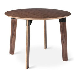Gus Modern Sudbury Table - The Sudbury Table by Gus Modern is a study in contrasts. Organic forms joined together by industrial fittings. Warm wood grain stands out against sleek steel. Scaled for smaller spaces, this table's rounded shapes create a relaxed vibe that's perfect for a modern dining area. It features exposed ply legs and beveled tabletop with fittings made from durable, powder-coated steel. Available in walnut with black brackets, or natural oak with white.
