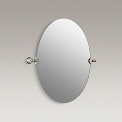 KOHLER - KOHLER Revival(R) oval mirror - Bring the essence of Art Deco to your bathroom with Revival accessories, which incorporate elliptical shapes and rolled edges inspired by classic 1920s design. At home in both traditional and contemporary bathrooms, this frameless oval mirror mounts securely to the wall with decorative metal brackets.