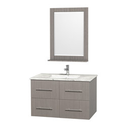 Wyndham Collection - 36 in. Vanity Set in Gray Finish - Includes matching mirror with shelf. Faucets not included. Two functional drawer. Two functional door. Plenty of counter and storage space. Brushed chrome exterior hardware finish. Single faucet hole mount can be drilled for 3-hole faucets on site. Concealed soft-close door hinges. Fully-extending under-mount soft-close drawer slides. Deep doweled drawers. Unique and striking contemporary design. Highly water-resistant low V.O.C. sealed finish. 12-stage wood preparation, sanding, painting and finishing process. Lifetime warping prevention. Square porcelain undermount sink. White Carrera top. Made from solid oak wood. Vanity: 36 in. W x 21.5 in. D x 22.75 in. H. Mirror: 24 in. W x 5 in. D x 32 in. H. Handling Instructions. Assembly Instructions - Vanity. Assembly Instructions - Countertop. Assembly Instructions - Sink. Assembly Instructions - MirrorSimplicity and elegance combine in the perfect lines of the Centra vanity by the (No Suggestions) collection. If cutting-edge contemporary design is your style then the Centra vanity is for you - modern, chic and built to last a lifetime. Available with green glass, pure white man-made stone, ivory marble or white Carrera marble counters, and featuring soft close door hinges and drawer glides, you'll never hear a noisy door again! Meticulously finished with brushed chrome hardware, the attention to detail on this beautiful vanity is second to none.