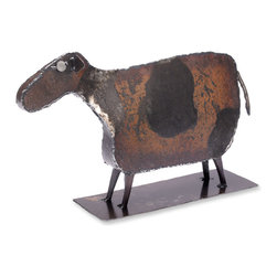 Cow Sculpture - This Cow sculpture is handmade in Pennsylvania by Ben Gatski. The metal we used is from weathered steel. We hand draw the pattern on the metal with soapstone and cut it with a hand held plasma cutter. We then hand hammer and weld it into shape.