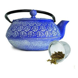 Epoca - Cast Iron 40 OZ. Teapot Blue - Primula's Japanese Blue Floral Cast Iron Teapot is reminiscent of Japanese cherry blossoms. This traditional blue teapot is as exquisite as it is durable. Cast iron teapots are designed to deliver exceptional tasting tea every time. They distribute heat more evenly therefore enhancing the flavor of the tea leaves during the brewing process. The cast iron design also traps the heat inside keeping your tea hot for up to an hour. Primula's teapot has a distinctive floral pattern on the outside a tall looped fold-down handle a removable lid and a short curved spout. Included is a loose tea mesh infuser that sits securely in the pot while the leaves are brewed. The interior of the teapot is fully enameled which makes for easy care and cleaning and helps prevent rust and oxidation. This teapot holds 40 oz of your favorite hot tea. Included is a packet of loose green tea so you can enjoy a delicious cup as soon as you open the box.