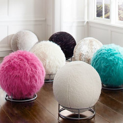 Fur Rockin' Roller Desk Chair - These desk chairs are actually exercise balls upholstered in fur! You can bounce them around, sit on them, or place them in the metal frame and just roll them around.
