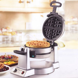 "Frontgate - Double Belgian Waffle Maker - Rotary control provides even baking on top and bottom for a crisp crust and tender interior. Audio alert beeps 6 times when waffle maker is heated and ready to use, and when waffles are done. Extra-deep 1"" waffle pockets. Batter won't stick to the ultra-smooth nonstick interior, allowing quick and easy release of waffles. Cool-touch handle features wide easy-hold grip. Serve two delicious Belgian waffles at the same time with our Double Belgian Waffle Maker. This powerful 1,400-watt unit ensures all 4 sides cook evenly and simultaneously. With this restaurant-quality waffle maker, you can custom-select the precise browning level from six settings and enjoy the exact golden texture and desired crispness every time.  .  . .  .  . Brushed stainless-steel housing . 36"" cord ."