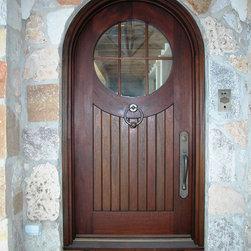 HeartWood Traditional Doors - Custom mahogany round-top door with plank panel.