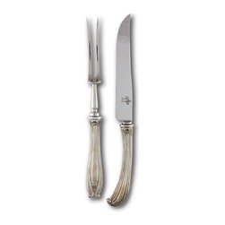 Lily Carving Set - Traditional shell and bead detail work combines with sleek, elegant outlines in the Lily Carving Set, making this pewter-handled knife and meat fork pair a perfect tool for the table when engaged in one of the most traditional forms of dinner-table serving. Curved handles with diminutive bud ends increase the turn-of-the-century appeal of these carving utensils.
