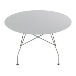 Kartell - Glossy Round Table - Glossy Round Table is available with Chrome Legs and a Zinc White Laminated, Red, White or Black Table Top. A collection of tables ideal both for the home and the office, characterized by a sophisticated design and elegant finishing.  Also ideal as a dining table for the home.  52 inch width x 28.5 inch height.