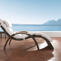 Nari Rattan Patio Chaise Lounge L1202 - This modern classic will instantly bring style, comfort and durability to your patio decor.