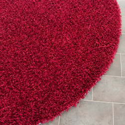 Safavieh - Shag Shag Round 5' Round Red Area Rug - The Shag area rug Collection offers an affordable assortment of Shag stylings. Shag features a blend of natural Red color. Hand Tufted of Polyester the Shag Collection is an intriguing compliment to any decor.