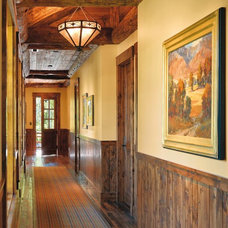 Rustic Hall by Kotzen Interiors, LLP