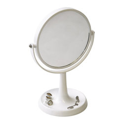 Magnifying Dual-Sided Vanity Mirror with Base For Jewelry White - This magnifying dual-sided vanity mirror features a durable plastic frame with a base for jewelry. This mirror rotates side to side providing versatile viewing. The 3X magnification side is perfect for viewing up close in detail for touch-ups and the regular side is ideal for all-around hairstyling and cosmetics. Plus, this unique mirror includes a base to store your jewelry, rings and more. Diameter of 7.28-Inch and height of 10.83-Inch. No assembly required. Clean with warm soapy water. Color white. This magnifying vanity mirror is perfect for use on any countertop and will give your bathroom a stylish and elegant style! Complete your decoration with other products of the same collection. Imported.