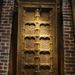 Antique hand carved double door with original brass & iron work. -