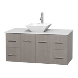 """Wyndham Collection - Centra 48"""" Grey Oak SGL Vanity, White Stone Top, White Porcelain Sink, No Mrr - Simplicity and elegance combine in the perfect lines of the Centra vanity by the Wyndham Collection. If cutting-edge contemporary design is your style then the Centra vanity is for you - modern, chic and built to last a lifetime. Available with green glass, pure white man-made stone, ivory marble or white carrera marble counters, with stunning vessel or undermount sink(s) and matching Mrr(s). Featuring soft close door hinges, drawer glides, and meticulously finished with brushed chrome hardware. The attention to detail on this beautiful vanity is second to none."""