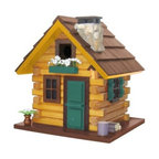 Home Bazaar Country Comfort Birdhouse - The Home Bazaar Country Comfort Birdhouse is a rustic, log cabin design that'll have your birds thinking twice about heading south for the winter. This adorable Cottage Charmer Series birdhouse features hewn timbers, a stone chimney with chimney cap, forest green front door and window trim, a wood pile and chopping block, flower pot, and more decorative details that radiate personality and charm. Your new birdhouse also comes with a mounting plate for easy installation on a wooden 4x4 and a steel cable for hanging.About Home BazaarCombining their love of birds and nature with their technical and design abilities, the people of Home Bazaar set out to create the world's most spectacular line of birdhouses and birdfeeders in 1999. They've even created a line of architectural birdhouses, feeders, pedestals, and garden accessories. These items are created using only the finest materials and with painstaking attention to detail. Each product is manufactured for functional use and to be enjoyed for years. Distinctive bird houses and feeders can be matched with accommodating pedestals and these pieces can be placed in the backyard or the garden. Cottage designs and pieces with Victorian scrollwork often end up on covered porches or inside the home as decorative accents.