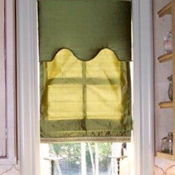 Shades and Blinds - This is an inside mounted roman shade with a cornice.