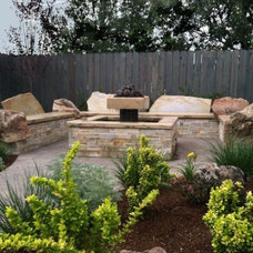 Eclectic Patio by The Garden Artist LLC
