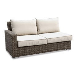 Thos. Baker - Wicker Loveseat L Sectional | Hampton Collection - Oversized seating in all-weather wicker with a slightly weathered look inspired by classic whitewashed country home styles. Premium, dyed-through resin wicker with an extra large diameter profile and elegant ocean gray finish. Powder-coated aluminum subframe and brushed aluminum feet.Plush Sunbrella cushion sets included where applicable. Choose quick ship in khaki with cocoa piping, stone green or choose from our made-to-order fabric options.Made-to-order cushion sales are final and ship in 2-3 weeks.