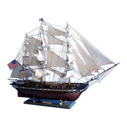 Handcrafted Nautical Decor - USS Constitution 38'' - Wooden Tall Ship Model - Tall Model Ship - Naval Warshi - SOLD FULLY ASSEMBLED--Ready for Immediate Display - Not a Model Ship kit--With exquisitely fine craftsmanship, unmatched features and careful attention to every detail, these scale replica tall ship models of the USS Constitution are certain to please even the most discriminating enthusiast of naval history.�� Whether the highlight of an office or den, or the centerpiece of a nautical themed meeting room or family living room, �Old Ironsides� will evoke wonder at her manifest detail and inspire historical pride with her indomitable spirit.--38'' Long x 10'' Wide x 28'' High (1:64 scale)----    Built from      scratch over      hundreds of hours by master artisans--    High quality      woods include      cherry, birch, maple and rosewood--    Individual wooden planks used in hull construction--    200% more rigging than 30� tall ship models      features over 200 blocks and deadeyes--    Two anchors weigh aside the bow--    Cannon carriages      tied-down to      deck to reduce recoil--    Amazing Details, including:--    --        Planked deck with nail holes--        Authentic scale lifeboats--        Rudder chains, cannonball       racks--        U.S. shield on the bow--        Handcrafted rosewood eagle on       the stern--        Solid brass cannons and metal       anchors --        Additional deck details such as cannon balls, barrels, etc.--        23 masterfully stitched, heavy       canvas sails hold shape and do not wrinkle --        Taut rigging with varied       thread gauge and color--    --    --    Meticulous      painting      accurately matches the actual USS      Constitution --    Wooden display      base features      four arched dolphins--    --        Pictured with marble base (available for purchase)--    --    --    Extensive      research of      original plans, historical drawings and paintings as well as actual      photographs ensures the highest possible accuracy--
