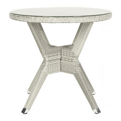 Safavieh - Langer Round Accent Table - So good looking you will want to use it indoors, the grey Langer round accent table by Safavieh combines the woven look of old fashioned wicker with state of the art weather resistance. This table is crafted of PE wicker and aluminum for easy care.