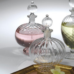 LaBoheme Perfume Bottles - Small - Pleasing additions to traditional vanity arrangements and sunny windowsills, the LaBoheme Perfume Bottles are classic glass pieces that create a vintage-inspired fantasy of the intimate boudoir or a playful personal touch.  Fluted round stoppers reflect the ribbed shape of the round body below, lines that continue onto the foot for a look of feminine delicacy that's immediately elite.