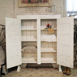 Painted Cottage Shabby White Farmhouse Cupboard by The Painted Cottage - I envision this filled with books, but this cupboard is awesome storage space for just about anything. As a bonus, the doors can be closed, so you don't have to worry about how messy the contents look.