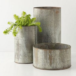 Ridged Zinc Pot - These metal canisters could house cotton balls and other toiletries in the bathroom, or a cute plant in the kitchen window sill.