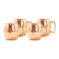 24-Ounce Solid Copper Moscow Mule Mugs, Hammered Finish, Set of 4 - This unique and stylish hammered finish mug is constructed of solid copper with nickel lining and solid brass accents, the made-to-last mug features a coating of resilient lacquer that resists tarnishing for lasting beauty and luster.  The mug of choice when serving the famous Moscow Mule--a cocktail made from a blend of vodka, ginger beer, and lime juice.