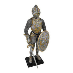 Medieval French Knight In Armor Statue Figure Armour - This awesome decorative statue depicts a medieval French knight in full armor, his left hand holding a shield,a sword in his right hand. The detailing is exquisite, with gold hand-painted accents on the armor, sword and shield. Made of cold cast resin, the statue measures 13 inches high, 6 inches wide, and is 4 1/2 inches deep. It makes a great gift for medieval history lovers.