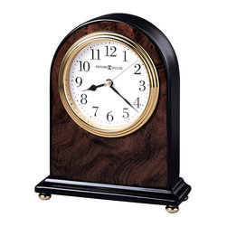 """Howard Miller - Walnut Finished Wood Mantel Clock with Inlaid - This elegant, highly attractive clock is made to give a fashionable, stylish feel to any room. The beautiful, dark color is given by a walnut piano finish, with wood burl patterns that give the piece a subtle texture. The clock is accented with a brass finish. * An attractive high-gloss walnut piano finish on a hardwood arch table clock featuring a wood burl pattern on the front and back, with black sides and base.. Polished brass button feet. . Polished brass tone waterfall bezel and glass crystal. The off-white dial offers black Arabic numerals, black hour and minute hands, with a brass second hand. . Quartz movement includes battery. . H. 6-1/2"""" (17 cm). W. 5-1/4"""" (13 cm). D. 2"""" (5 cm)"""