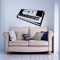 None - Synthesizer Musical Instrument Black Vinyl Wall Decal - Bring style to your home or business with this beautiful vinyl art featuring a synthesizer musical design. A great decorative innovations of recent years,vinyl wall decals are easy to apply and an inexpensive way to decorate your favorite space.