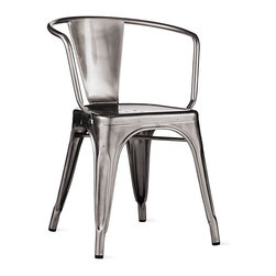 Design Within Reach - Tolix® Marais A56 Armchair - Metalworker Xavier Pauchard not only brought the art of galvanizing steel to France but also took the process to the next level by creating the Marais A Chair (1934). The quintessential cafe chair, it was both elegant and robust enough to grace the decks of the S.S. Normandie ocean liner. After the death of Pauchard in 1948, his son Jean took over as managing director of their company, Tolix. In 1956, he designed an armchair to go with his father's A Chair, naming it the A56. It takes 100 manual operations to create a Tolix chair, and 80 years after the company was founded, the Tolix name is recognized worldwide as best-in-class furniture. All Tolix furniture is still made in Autun, the same Burgundy town where the company first began. Slight surface abrasions and markings are characteristic of the material and part of its hardworking machine aesthetic. Stackable up to 10 high. Made in France. Tolix products are protected by copyright, making it illegal for another company to clone this chair. At DWR, the Tolix products we sell are 100% authentic. The Marais Collection should be protected from moisture and kept indoors when not in use to maintain its finish. DWR Exclusive
