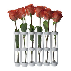 "Danya B. - Six-Tube Hinged Vases on Rings Stands - This hinged vase with six 9"" glass vials on a metal stand is easy to arrange with just a few flowers. Hinges allow you to set vase different ways for a playful accent. Made of recycled glass and iron."