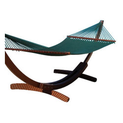 Jumbo Sized Green Weather Resistant Hammock - This beautiful jumbo sized, green Caribbean hammock is hand woven from soft spun polyester, and can last up to 5 times as long as similar cotton hammocks. The bed of the hammock is woven with an extra tight micro-weave design, providing the ultimate in comfort and stability. The wood spreader bar has multiple coats of marine varnish to protect it from the elements and is a full 55 inches wide giving ample room for any sized couple (It has a 500 pound capacity!). This hammock hangs easily from two suspension points that are 11.5ft or more apart. unlike cotton hammocks they will not rot, mold or mildew. These are the largest and most comfortable hammocks anywhere. NOTE: It does not come with stand or mounting hardware.