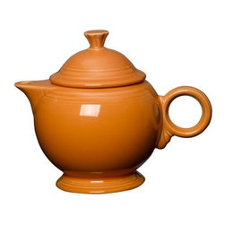 Fiesta Tangerine Covered Teapot - 44 oz. - About FiestaAmerica's favorite dinnerware line, Fiesta was introduced by the Homer Laughlin China Company in 1936. Available in plenty of bright, vibrant colors and unique shapes, Fiesta dinnerware and serveware features Art Deco-style concentric rings. Made from durable, restaurant-quality ceramic and finished in lead- and cadmium-free glazes, this line of kitchenware is easy to mix and match to create your own custom set. Best of all, each piece is microwave- and oven-safe, and dishwasher-safe for easy cleanup.