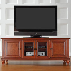 Crosley - Crosley Cambridge 60 in. Low Profile TV Stand - Classic Cherry Multicolor - KF10 - Shop for Visual Centers and Stands from Hayneedle.com! Elegantly turned feet and versatile media storage make the Crosley Cambridge 60 in. Low Profile TV Stand - Classic Cherry a natural choice for your home. This entertainment cabinet has a lower profile and supports most 60-inch flat panel TVs. It is made of hardwood and quality veneers with a hand rubbed multi-step classic cherry finish accented by antique brass hardware. Three adjustable shelves offer plenty of versatile storage while the cord management feature tames the unsightly mess of tangled wires. Two raised panel doors conceal stacks of DVDs games and media components while tempered glass doors protect electronic components from dust and allow remote control access. Sized to accommodate today's larger homes.Additional Features:Accommodates up to a 60-inch flat panel TV3 adjustable shelves give 6 levels of protected storageDual tempered glass doors allow remote control access2 side cupboards with raised panel doors and 1 adjustable shelf eachCord management featureAbout Crosley FurnitureIn 1920 Powel Crosley founded the company that pioneered radio broadcasting and mass market manufacturing around the world starting with a simple radio meticulously crafted with obsessive detail and accuracy and a measure of consideration for the wallet. These high ideals have served the company well for over 90 years and they live on in the newest addition to the family. Crosley Furniture sets a new standard for innovation function and meticulous craftsmanship in the manufacture of value-priced furniture. They proudly offer durable furniture products featuring hardwood and veneer construction with rich multi-step finishes in a multitude of styles.