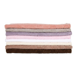 Italian Cotton Bath Mats - Every bathroom needs a bath mat that is soft, pretty and washable! I don't understand why anyone would put a rug in the bathroom that can't be thrown in the washing machine. These Italian cotton rugs fit the bill perfectly and they come in the most beautiful muted colors. So pretty.