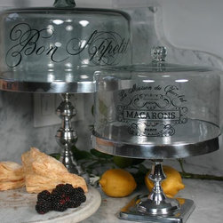 """Home Decorators Collection - Aluminum Cake Stand - This Aluminum Cake Stand will spectacularly present your favorite desserts such as cakes or cupcakes. Can also be used to hold everything from hors d'oeuvres to warm cheeses. Aluminum and glass construction. Select from """"Bon Appetit"""" or """"Macaroon"""" designs."""