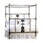 Dunbar California King Iron Bed, Antiqued Black - A gorgeous statement in the bedroom, this Dunbar iron bed is the perfect fit for your space. Gorgeous cast iron details are found at the center of the head and foot of the iron frame bed and a framed canopy lends drama and height to the gracious bed. Spotlight this bed to perfection with creamy white linens, or use a bright quilt for a more relaxed look.