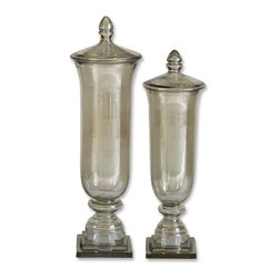 """Uttermost - Uttermost Gilli Traditional Container X-84191 - Not only are these containers pretty, made from transparent pale green glass: they are also multi-functional. Use them to display colorful beads or remove the lids and use as a vase for those special cut flowers or simply display them as they are. Sizes: Small (6"""" x 22"""" x 6""""), Large (7"""" x 26"""" x 7"""")."""