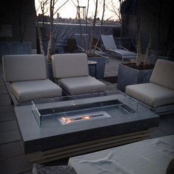 Brooklyn, NY Outdoor Concrete Fire Table - Designed and built for a client in New York, this table rests on casters so that it can be easily moved to anywhere on the terrace. The recess in the table top is sloped ever so slightly toward the center so that rainwater can drain underneath the burner.