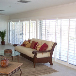 Window Treatments for Sliding Doors - 4 1./2 in wood plantation shutters used here to disguise unattractive and dated sliding glass doors