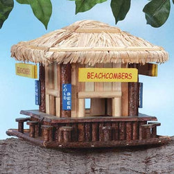 Wood Beachcomber's Birdhouse - This little birdhouse will put you in a beach vacation mood each time you see it.  What a cute whimsical design for the backyard. It would look especially great mounted near a backyard pool or backyard cabana.
