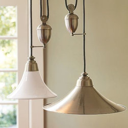 Porter Pendant - Modeled after the antique lamps that once lit workshops in Paris, our Porter Pendant functions the same way the originals did, allowing you to easily lower or raise the pendant to light your space your way.