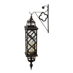 Lazy Susan - Lazy Susan 594033 Aged Black Quatrefoil Lantern - Here's a lantern that may have even kept Paul Revere at home. It's handcrafted of dark, distressed iron that features quatrefoils on the body and hanging bracket. Add a pillar or flameless candle to the glass insert and light up your midnight rides through house and garden.