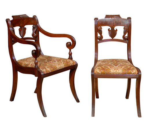 Consigned Set of 8 Regency Dining Chairs - Bring drama to your dining room with this impeccable set of French Regency chairs, circa 1820s. Beautiful crafted of mahogany, The set includes two dining armchairs and six side chairs, featuring intricate carving and a rich finish that elevates every meal to a special event.