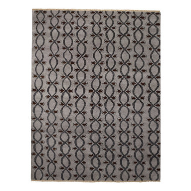 Infinity rug in Charcoal - There's just something about the perfect rug that can really ground a sense of place in your home. Taking its cue from the infinity sign, which dates back to the Roman era, we envision this rug as a part of your décor that inspires togetherness and community.