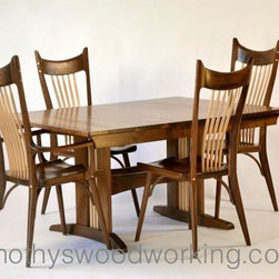 Walnut Dining Table and Chairs Set - Walnut dining table and chairs of walnut and curly maple with curved trestle and hand-carved chairs.
