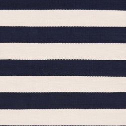 Catamaran Stripe Navy/Ivory Indoor/Outdoor Rug - Perfectly proportioned bands of rich navy and warm ivory pull a room into ship-shape with a boldly classic nautical statement. This indoor/outdoor accessory from Dash & Albert exemplifies the casual spirit of striped patterns, one of the easiest and most versatile motifs to incorporate into relaxed living spaces. Lightweight, scrubbable, and durable, this timeless design of equally scaled horizontal bars will function as a neutral and see you through many years and redecorating projects.