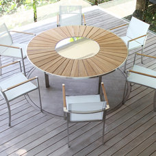 Contemporary Outdoor Dining Tables by d`apostrophe llc