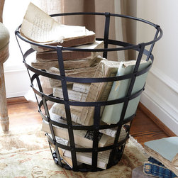 Iron Catch-All Basket - A handsome alternative to your standard storage basket, this beautiful piece reproduces an antique design found in the south of France. Crafted of solid wrought iron with a rusted, powder-coated finish, you'll find a purpose for it in any room - whether it's storing blankets, magazines or firewood.