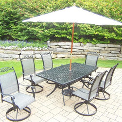 Oakland Living - 9-Pc Traditional Cast Aluminum Dinning Set - Includes boat shaped table, six swivel rockers, 9 ft. umbrella with stand and metal hardware. Traditional lattice pattern and scroll work. Hardened powder coat. Handcast. Fade, chip and crack resistant. Warranty: One year limited. Made from sling. Black color. Minimal assembly required. Table: 70 in. W x 38 in. D x 29 in. H (75 lbs.). Swivel Chair: 24 in. W x 30.5 in. D x 40 in. H (16 lbs.)The Oakland cascade collection combines southern style and modern designs giving you a rich addition to any outdoor setting. We recommend that the products be covered to protect them when not in use. To preserve the beauty and finish of the metal products, we recommend applying an epoxy clear coat once a year. However, because of the nature of iron it will eventually rust when exposed to the elements.